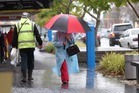 DOWNPOUR: Pedestrians in Gloucester St in Taradale make sure they are protected against the elements this morning as the rain sets in. PHOTO/DUNCAN BROWN