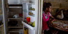 Andrea Sira, 11, at her home on the outskirts of Barlovento. The only food in her fridge was water and mangos. Photo / Alejandro Cegarra for The Washington Post