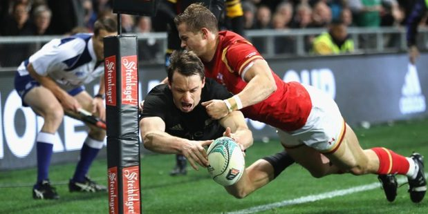 Loading Ben Smith evades Hallam Amos to score the All Blacks opening try. Photo / Getty