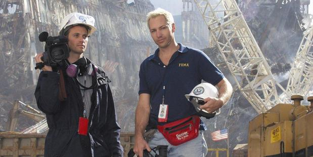Kurt Sonnenfeld, right, holds a camera at ground zero in September 2001. Photo / AP