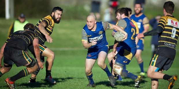 Loading Tauranga Sports' elusive fullback Steve Honey makes another break against Greerton Marist on Saturday. Photo / Andrew Warner