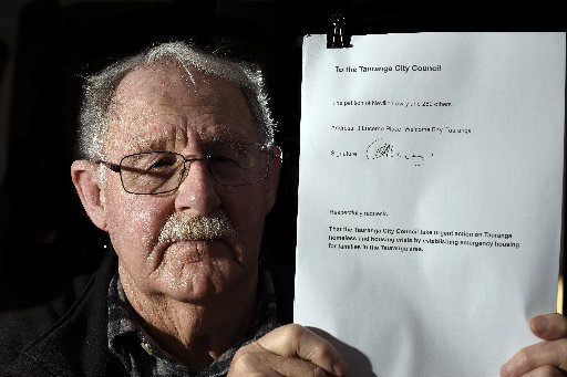 Neville Lowry with his petition. Photo / George Novak