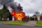A house exploded into flames today