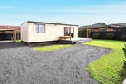 The property for sale at Rollerson St, Papakura has a CV of $225,000, but the seller hopes for $549,000.