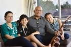 Maori Language Commission CEO Ngahiwi Apanui with his partner Hinerangi Barr and children  Maarie and Natai at their home in Wellington. Photo / Marty Melville
