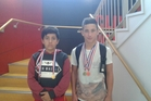 Tainui, 12, (left) and Arapo Kellner, 14, with their championship medals after a successful New Zealand Olympic Wrestling North Island championships.