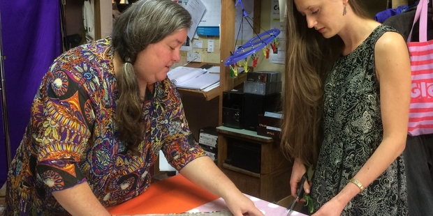 Joy Wright, left, teaching Brydie Senior the importance of notching while sewing.