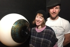 Armagan Ballantyne (left) and Jon Baxter with the giant eye installation at Motat as part of the new exhibition. Photo / Supplied