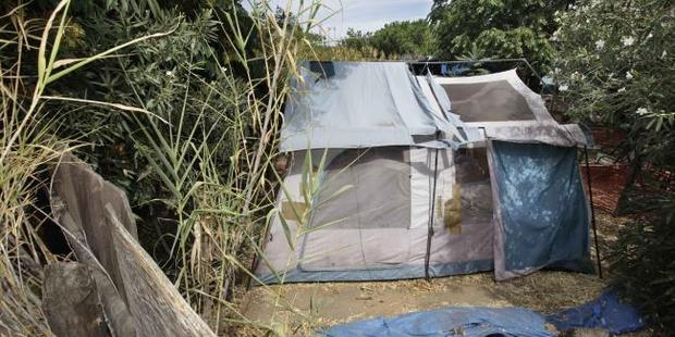 A tent is set up in the far backyard of a home in Antioch, California. Photo / AP
