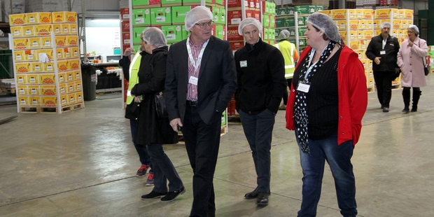 Geoff and Cam Lewis from Tendertips Asparagus in Horowhenua, with Jodi Johnstone from Trevalyn's Pack and Cool, Te Puke, during a tour of the packhouse at Crasborn Fresh Harvest, Hastings. Photo / Duncan Brown