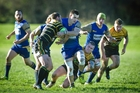 Tauranga Sports midfielder Jacob Proctor is tackled against Greerton Marist last week.