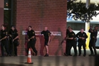 Dallas police respond after snipers opened fire during protests over recent fatal shootings, killing five officers and wounding six others. Photo / AP