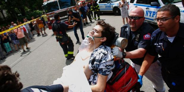 A critically injured man lies on a stretcher after an explosion at Central Park in New York. Photo / AFP