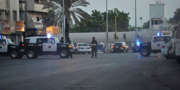 Saudi policemen stand guard at the site where a suicide bomber blew himself near the American consulate in the Red Sea city of Jeddah. Photo / AFP
