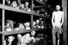 This April 16, 1945 file photo provided by the US Army, shows inmates of the German KZ Buchenwald inside their barrack, a few days after US troops liberated the camp. Photo / AP