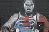 Two men take a selfie in front of a mural of NBA Oklahoma City Thunder center Steven Adams. Photo / AP