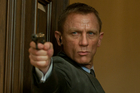 Daniel Craig nearly cost the producers of James Bond film Skyfall millions by wearing a pair of leather gloves in a scene, according to a film critic.