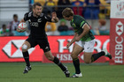 Kurt Baker fends off Kwagga Smth during the match between New Zealand and South Africa on day two of the 2016 World Rugby Sevens Series. Photo / File