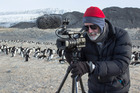 Film-maker Anthony Powell filming penguins in Antarctica. Photo / Anthony Powell © Antarctica New Zealand Pictorial Collection, 2015-2016