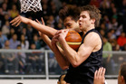 Tom Abercrombie collects the rebound against South Korea. Photo / Getty Images