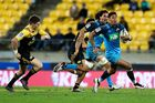 Melani Nanai of the Blues makes a break against the Hurricanes. Photo / Getty