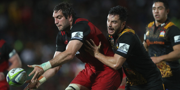 Sam Whitelock is tackled by James Lowe during round 15 of Super Rugby. Photo / Getty Images