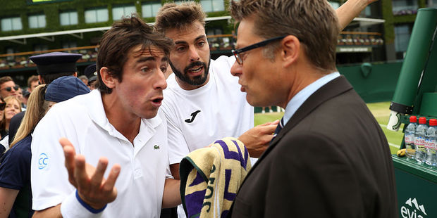 Pablo Cuevas (L) and Marcel Granollers (R) argue with the match referee. Photo / Getty