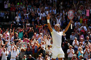 Roger Federer celebrates victory during the Wimbledon quarter-finals. Photo / Getty