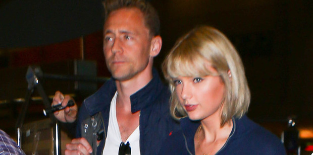 Taylor Swift and Tom Hiddleston are seen at LAX before heading to Australia for Taika Waititi's Thor. Photo/Getty