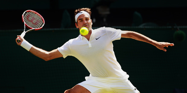 Roger Federer plays a forehand during his match against Marin Cilic. Photo / Getty Images