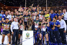 The Cowboys celebrate on the podium with the premiership trophy after winning the 2015 NRL Grand Final. Photo / Getty Images.