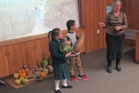 PUANGA: Sandra and Jahmane check out gourds under the direction of Whanganui Regional Museum educator, Margie Beautrais. PICTURE / SUPPLIED