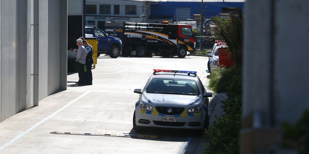 Police at the scene of a fatal workplace accident in Silverdale on Friday. Photo / Doug Sherring