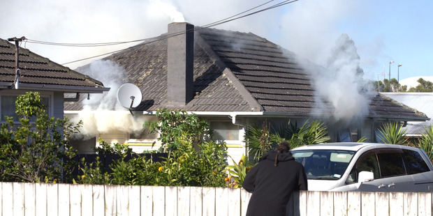 DESTROYED: A house burned down in East Tamaki. PHOTO/NZME