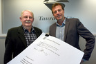 Neville Lowry presents deputy mayor Kelvin Clout with a petition calling for urgent emergency housing. Photo/George Novak