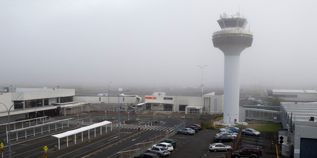 A blanket of fog over Auckland International Airport is causing flight delays and cancellations. Photo / Mark Mitchell