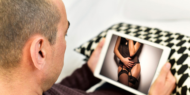 Discovering your partner prefers looking at nude strangers on a screen to being intimate with you can be humiliating. Image digitally altered. Photo / Getty Images