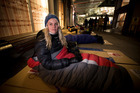 New Zealand Herald reporter Catherine Gaffaney takes part in the Big Sleepout held at AUT. Photo / Dean Purcell