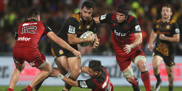 Chiefs winger James Lowe takes on the Crusaders' defence in Suva last Friday. Photo / Getty Images