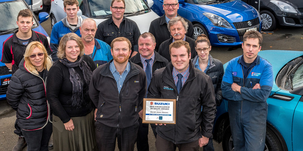 WINNERS: Gareth Jones (centre) with the sale trophy and the team at David Jones Motors PHOTO/SUPPLIED