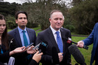 Prime Minister John Key addresses the media over the Auckland housing issues after a function in West Auckland today. Photo / Dean Purcell