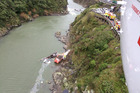 Two people are winched to safety after their truck plunged into the Manawatu Gorge Friday. Picture / Philips Search & Rescue Trust