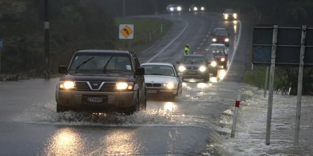 Flooding just north of Katikati closed the road to traffic one way. Photo / John Borren