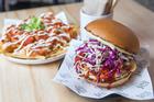 Kimcheese Fries and Goguma Burger (Crispy Shiitake & Kumara Patty, Slaw, Yang Nyum Sauce and Mayo) from Tiger Burger. Photo / Greg Bowker