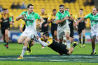 Ben Smith of the Highlanders is tackled by Cory Jane of the Hurricanes during the round 14 Super Rugby match between the Hurricanes and the Highlanders. Photo / Getty Images.