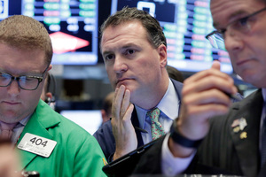 Trader Jonathan Corpina, centre, works on the floor of the New York Stock Exchange. Photo / AP