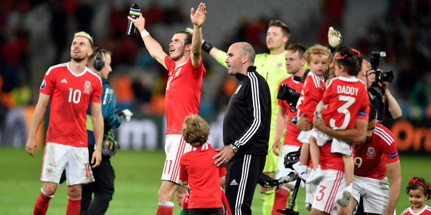 Wales players and their families celebrate the team's quarter-final victory. Photo / AP