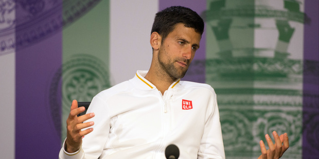 Novak Djokovic of Serbia gestures during a press conference, after being defeated by Sam Querrey of the U.S in their men's singles match on day six of Wimbledon. Photo / AP.