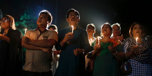 Bangladeshis light candles and sing songs as they pay tribute to those killed in the attack at the Holey Artisan Bakery in Dhaka, Bangladesh. Photo / AP