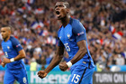 France's Paul Pogba celebrates after scoring his side's second goal during the Euro 2016 quarterfinal soccer match between France and Iceland. Photo / AP.